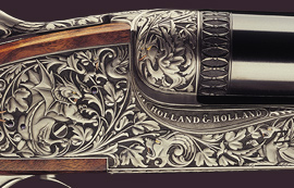 Un fusil Holland et Holland gravé de feuilles et branches qui se mêlent